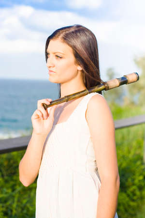 poignant: Dreaming Young Woman Wearing White Dress Stares Out Over The Sea Holding An Old Fashion Telescope In A Vintage Adventure Or Adventurer Concept Stock Photo