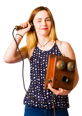 phoning: Portrait of young woman phoning using old vintage telephone. Isolated, studio shot Stock Photo