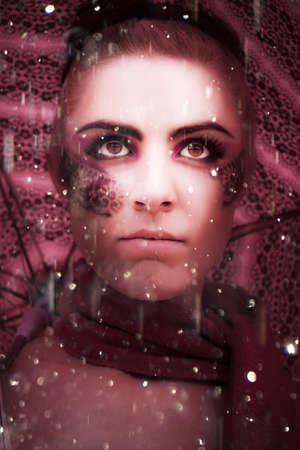 rain weather: Weather The Storm Is The Face Of A Woman Standing In The Rain Looking To The Distance With An Intense Gaze Showing Determination Willpower And Inner Strength