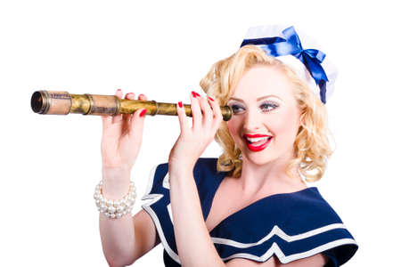 monocular: Happy blond American retro style pinup sailor girl holding monocular on white background