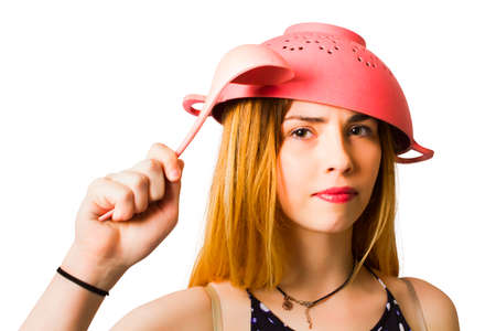 blonde girls: Comical image of a serious girl ready to battle dinner preparation with thinking cap and can do attitude. Ready for cooking action