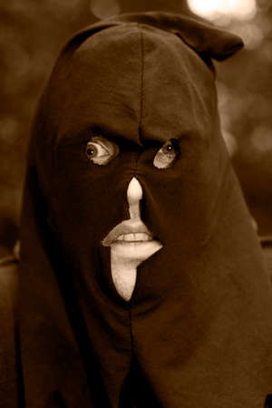 nightmarish: The Face Of A Historical Headsman Wearing A Black Hooded Mask Over His Face In A Nightmare Portrait Stock Photo