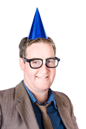 hogmanay: Head and shoulders image of a smiling nerdy man wearing party hat with smart glasses at work Christmas party