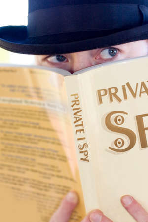 private i: Private Eye Man Spying Over A Private I Spy Novel