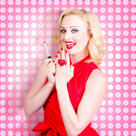 beauty girls: Pinup portrait of an attractive young retro fashion woman with red nails and bright red lips. Nail hand and makeup model Stock Photo