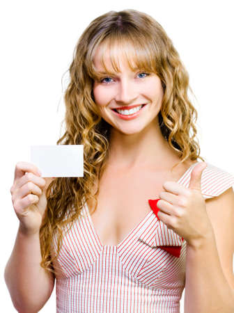 credentials: Upbeat beautiful woman with a lovely smile giving a thumbs up gesture while presenting her blank business card isolated on white