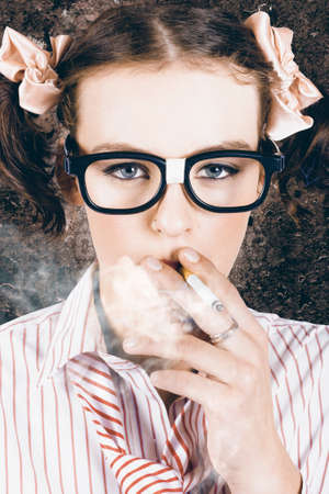 dweeb: Edgy grunge portrait of a hipster nerd smoking cigarette in a depiction of cool