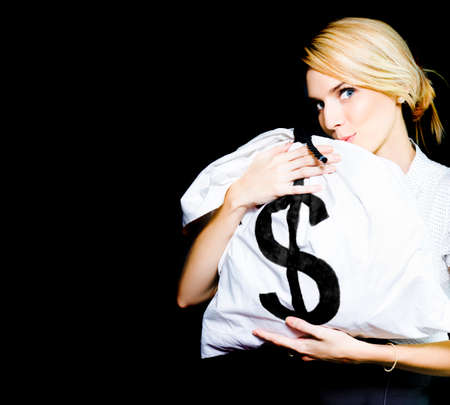 desirous: Studio Image Of A Business Woman Kissing A Money Bag Full Of Monetary Gains And Earning In A Winning Business And Financial Success Concept On Black Background Stock Photo