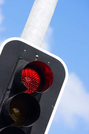 trafficlight: Red Traffic Light On Busy Roadside Intersection