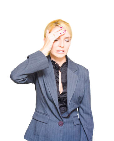 studio photograph: Isolated Studio Photograph Of A Distressed And Overworked Business Woman Holding Hand To Head With A Look Of Stress And Pain From A Migraine Or Headache Stock Photo