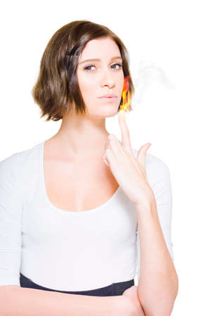 scorching: Confident Attractive Business Woman With Short Brunette Hair Blowing On Her Pointer Finger Engulfed In Fire And Flames In A Smoking Hot Business Deal Conceptual