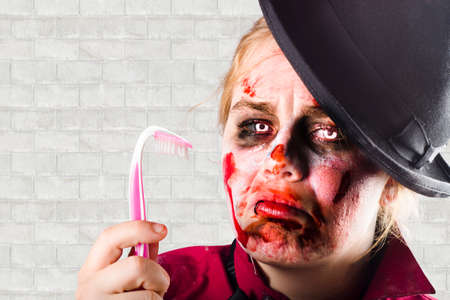 dentin: Humorous portrait of a monster holding sad bent over toothbrush. Tooth decay concept Stock Photo