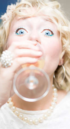 recluse: A Stressed Woman Who Has A Phobia Of Social Events Drinks Alcohol Quickly To Relieve Social Anxiety Stress – Focus On The Tip Of The Wine Glass Stock Photo