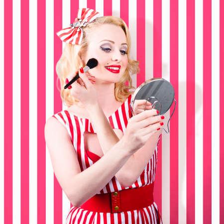 pins: Beautiful cosmetic woman applying make-up base foundation. Perfect pinup makeup