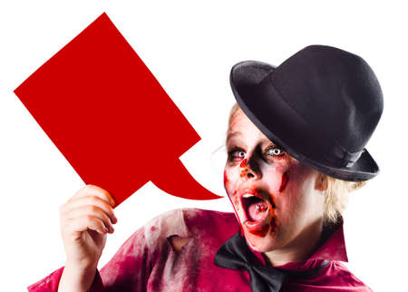 kill: Zombie woman shouting out a Halloween advert through a red dialogue bubble. Kill the messenger Stock Photo