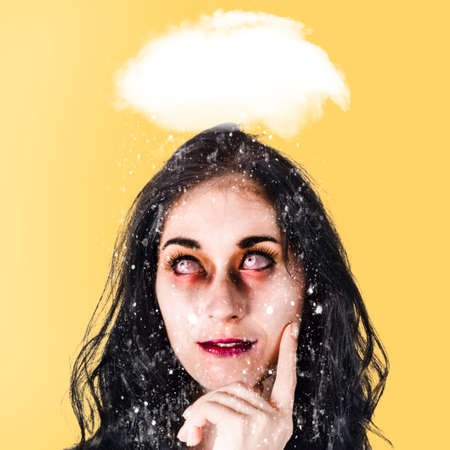 turmoil: Stressed undead businesswoman under cloud of chaos and turmoil brainstorming a way out of the haze and confusion Stock Photo