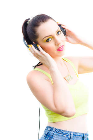 banging: Woman Listening And Rocking Out To The Sounds Of The 1980s While Holding Her Stereo Earphones On Head In A Head Banging Retro Rocking Portraiture Stock Photo