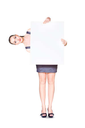commercialism: Sales Woman Turning Prices Upside Down And Inside Out When Holding A White Copyspace Sign On A Ninety Degrees Sideways Angle In A Funny Add Promotion