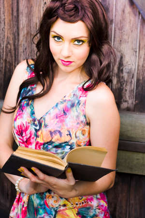 scholarly: In A Research And Education Effort A Young Pretty Woman Reads And Studies An Open Knowledge Booklet In An Attempt To Learn And Discover Information And Facts