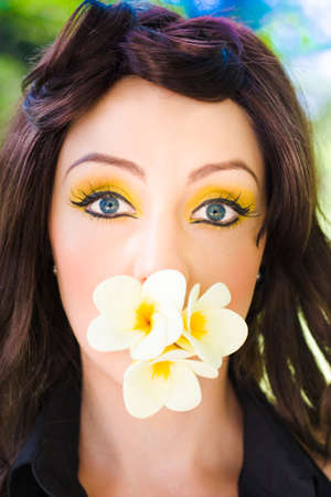 love pic: Flower Surprise Concept Sees The Face Of A Surprised Beautiful Young Woman Holding On To Frangipani Flowers In Her Mouth In A Quirky Funny And Humorous Love Pic