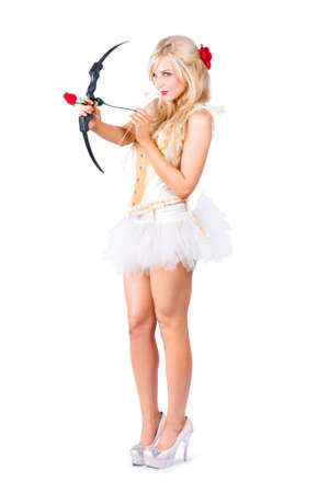 costumes: Sexy blonde cupid in high heels shooting a red rose arrow, isolated
