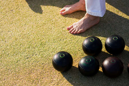 foot step: Bare Feet And Bowling Balls On A Lawn Bowls Green