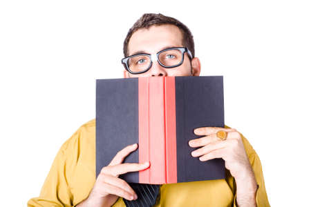 hiding face: Nerdy businessman with book in front of face, white background