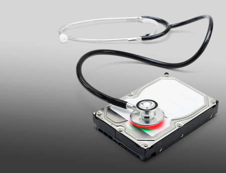 computer virus: Computer doctor fixing and recovering corrupt data and info while defragging and removing malicious software and viruses from a broken down pc Stock Photo