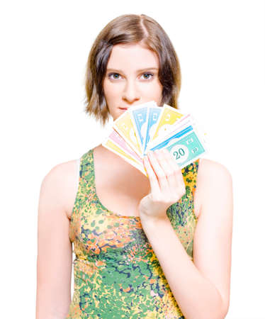 studio photograph: Isolated Studio Photograph Of A Perplexed And Stunned Young Female Holding A Fan Of Money In A Shopping Savings And Retail Discounts Conceptual; White Background