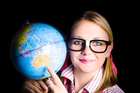 australia: Geography student pointing to melbourne australia on a world globe when discovering places and regions on planet earth Stock Photo