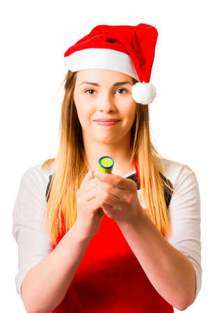 popper: Pretty girl in santa suit taking aim with party popper, isolated on white background. Christmas big bang countdown