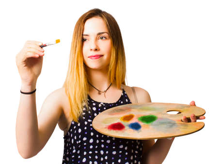 Fine arts student painting an artistic craft message with paintbrush and colour palette. Artist workshop