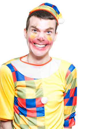 childrens birthday party: Funny Looking Joker In Clown Costume Laughing And Telling Jokes At A Childrens Birthday Party Celebration In A Depiction Of Comedy Entertainment Over White
