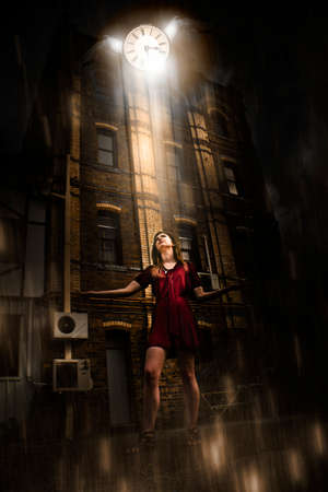 the passing of time: Woman In Dark Street Or Alleyway Watching A Flying Clock With Wings In A Lost And Dark Image Of Passing Time