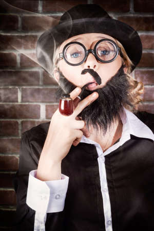 wonky: Funny prviate eye detective with wonky moe, fake beard, nerdy glasses and bowler hat smoking pipe at elementary (my dear watson) school