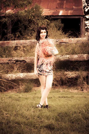 dark haired: A Pretty Young Woman With Ivory Skin And Stylish Floral Pattern Dress With Happy Smiling Expression Against Farm Background