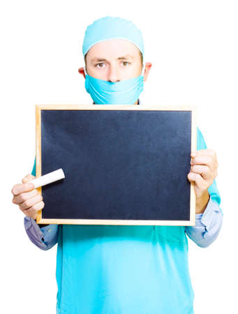 write: Doctor holding a blackboard and large stick of chalk ready to start teaching and educating you on medical facts and myths in a health education concept isolated on white