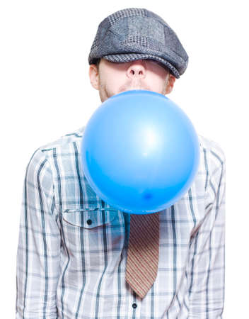 setup man: Young Man In Vintage Outfit Blowing Up A Blue New Years Eve Party Balloon On White Background