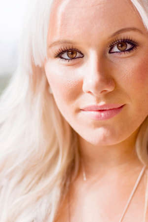blond haired: Portrait of attractive blond haired woman outdoors