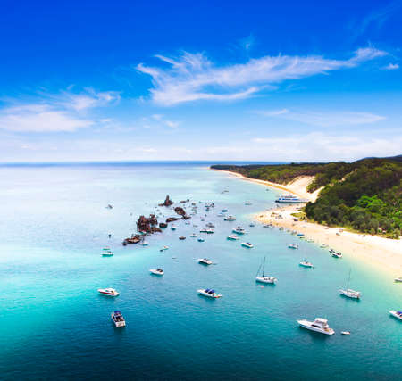 clear waters: Tangalooma Wrecks Landscape, Queensland, Australia. Beautiful scenic overhead view of ships moored in crsytal clear waters off the coast at Tangalooma Wrecks