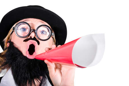 disguised: Woman With Fake Beard And Mustache Shouting Through Paper Megaphone Stock Photo