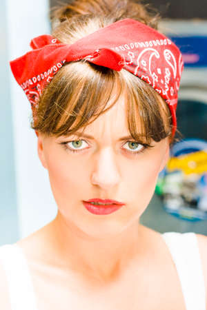 uptight: A Domestic Is Looming As Angry Rage Fills The Intense Stare Of A Bitter House Wife Woman Fuming Mad In Her Laundry Room In A Serious Head On Face Portrait Stock Photo