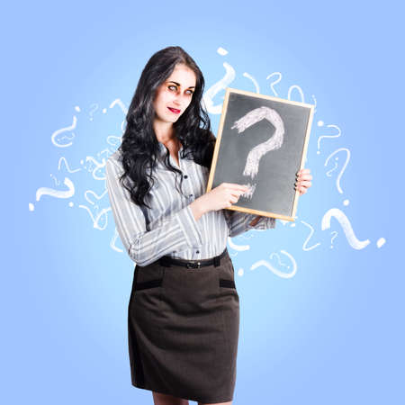 life after death: Ghostly business woman asking question on life insurance after death while holding a question mark chalk board on blue background Stock Photo