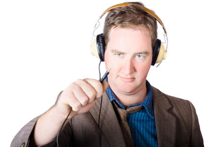 plugin: Isolated retro man about to plugin stereo headphones when tuning into a radio broadcast Stock Photo