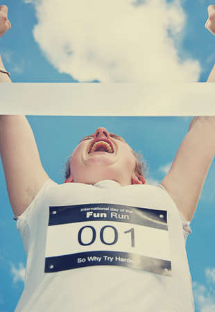 prevail: Fun Runner Throws Hers Arms Up At The Finish Line In First Place Celebration