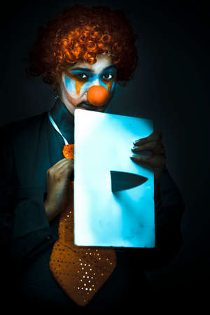 stabs: Chilling Image Of A Disturbed Clown With Knife Stabbing A White Sign