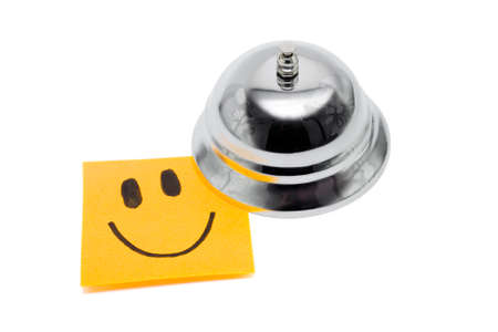 chiming: Reception Service Bell With Happy Face Note, In A Depiction Of Service With A Smile On White Background