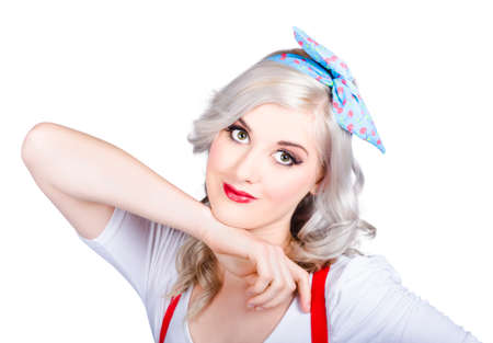 faraway: Isolated photo of a good looking 50s pinup girl wearing blue hair tie in blond hairstyle posing with faraway expression on white background