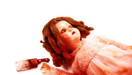 possessed: Possessed Evil Doll Covered In Blood Reaching For A Clever Knife In A Macabre Sinister And Wicked Horror Image Isolated On White Background Stock Photo