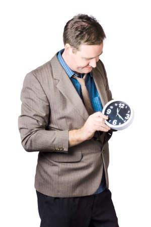 adjust: Businessman In A Suit Adjusting Time Of A Clock On White Background